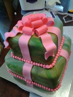 My niece requested a chocolate two tier girly camo cake with a pink bow. This was my artistic interpretation of her idea. Rave review so I guess I was spot on! This was done with marshmallow fondant dyed to Camo type tie-dye, Marshmallow Fondant bow and pink butter cream dots. Both tiers are chocolate.