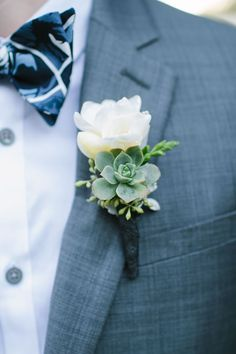 A simple and sweet boutonniere with a succulent for a rustic-vintage twist. Floral design by The Flower House.