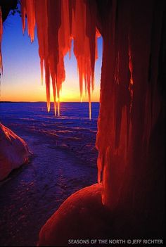 Lake Michigan Ice Caves | SN158 Ice cave icicles and setting sun at Lake Superior lakeshore