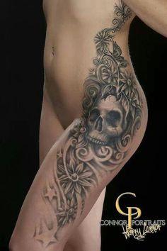 Black and gray skull flower star side piece tattoo
