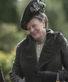 Still of Maggie Smith in Downton Abbey (2010)  Watch out when she gives you one of those smiles.