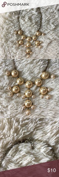 Francesca's Bauble Necklace A smaller version of the classic J Crew bauble necklace. Gold hardware with champagne pearl baubles. Chain has tarnished but it is unnoticeable when worn. Great condition! Perfect statement to add to a simple outfit. Dresses up a tank or sweater. Francesca's Collections Jewelry Necklaces