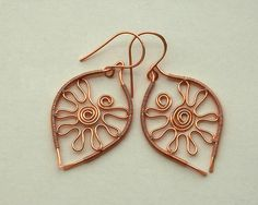Shimmering Sun: Wire wrapped copper earings by izabako, via Flickr