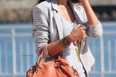 Very cute! The color of the purse is great as well.