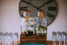 22 Stupefying - Surprising Wedding Photography Ideas : Enthralling two glass beverage dispensers filled with sliced fruits on top of brown wooden rack Weddings Under 5000, Beer Images, Glass Beverage Dispenser, Corporate Event Design, Gin Tonic, Surprise Wedding, Wooden Rack, Diy Bar, Magical Wedding