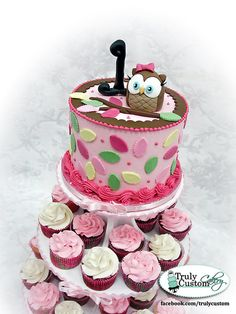 Cupcake Tower First Birthday Cake.. pinning for you @Tiffany Lieber.. you prolly already have one picked out but thought this was cute!