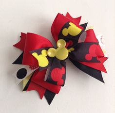 Made with -Yellow Mickey Mouse head - Red & Yellow Mickey Mouse ribbon - Polka dotted ribbon - Red & Black ribbons - reaches about 5 inches (approximately) - attached to an alligator clip (but can be changed to a French barrette UPON REQUEST)  * Disclaimer * All items sold in my shop contain small parts do not leave small children and babies unattended while wearing as they may pose a Choking Hazard !  Like me on Facebook & follow my work. Thank you!  www.com/AurorasChicBowti...