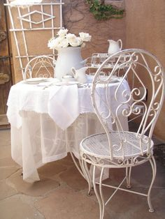 Gorgeous outdoor white metal bistro set. I have four of these at Jo Wray's, Hwy 82 E, Kilmichael, MS
