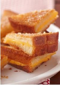 Ultimate Crispy Grilled Cheese Sandwiches – You may never make regular grilled cheese sandwiches again. To serve as appetizers, cut each sandwich into 8 mini triangles.