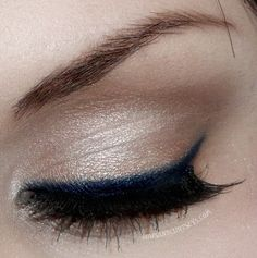 Navy blue eyeliner, and amazing thick lashes.