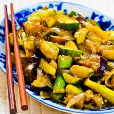 1 1/2 lbs zucchini, yellow squash, and/or eggplant, cut into same size pieces (use any combination of these vegetables) 2 T peanut oil or canola oil (or possibly a little more if you don't have a non-stick pan) 2 T finely minced garlic (or less) 1 onion, sliced top to bottom in strips about 1/2 inch wide 1/4 tsp. salt 3 T Oyster Sauce (look for it by the Asian foods in any supermarket)
