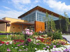 Morris Thompson Cultural & Visitors Center with historic cabin and garden out front. Fairbanks