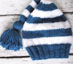 This hand knitted baby elf hat will make a fun baby shower gift. Knit in sapphire blue and white, this striped stocking cap has a ribbed brim and tassel at the tip. An adorable baby boy hat or baby girl hat for the cold months of fall and winter. It has some stretch and a soft, cozy feel. Its both practical as warm winter wear, and fun for producing a smile!  Fits approximately 0 to 6 month baby 13 to 16 inch brim circumference (33 cm to 41 cm)  This baby garment is new and unworn. I used…