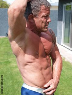 a muscleman big hard muscles hot nips flexing backyard
