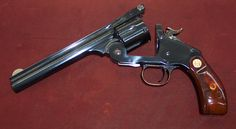Schofield top-break revolver (competitor to the Colt Peacemaker, which required a much slower reload.) A .45 Smith & Wesson revolver.