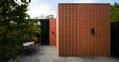 Three Parts House is an alteration and addition to a 1950s clinker brick residence by Australian architecture studio Architects EAT.