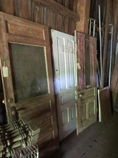 Found on EstateSales.NET: 3 Old Wooden Doors, 2 exterior doors and one 5  panel interior door