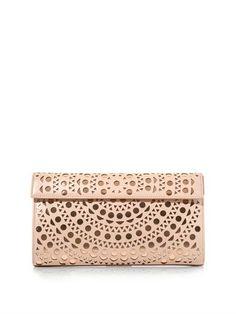 Laser-cut leather clutch   Azzedine Alaïa   MATCHESFASHION.COM