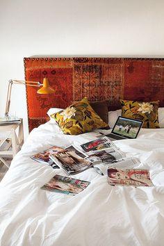 Vintage rug used as Upholstered headboard