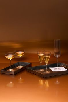 Drink + be merry. Entertain for the holidays with glass stemware from Calvin Klein Home.