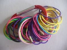 Stash hair ties with a carabiner. | 31 Ways You Can Reorganize Your Life With Dollar Store Stuff