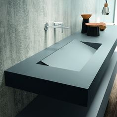Top in 10 cm thick Fenix bromine grey This top is manufactured using the innovative FENIX material, which combines refined aesthetic solutions with highly advanced technological solutions. The use of nanotech opens the doors to a new world in interior des New Bathroom Designs, Bathroom Design Luxury, Bathroom Design Small, Unique House Design, Dream Home Design, Modern Design, Concrete Sink Bathroom, Italian Bathroom, Convertible Furniture