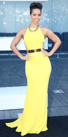 ALICIA KEYS Keys lit up the 27th Annual ARIA Awards 2013 in a sunny Stella McCartney gown, complete with a gold belt and a chunky gold chain necklace.