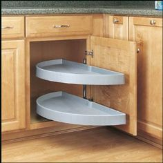 Amazon.com - Rev-A-Shelf 31in Half Moon Pivot & Slide Out White how perfect would THIS be for the pots and pans cabinet?