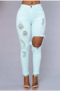 Mint colored broken distressed jeans at www.mavenofswank.com