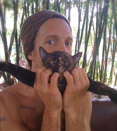 Jason Mraz...holding a cat that looks just like Phie! AND check out the tattoo. Awwww
