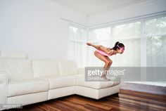 Stock Photo : Girl dives from sofa