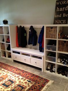 2 IKEA Bookcases+ IKEA TV Stand  'viola Mudroom extraordinaire! I live organization and the canvas in the corner that say work hard and be nice.