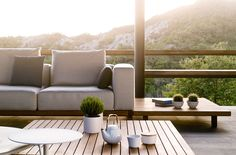 A coffee table in teak wood can be attached to the Vis à vis outdoor sofa from Tribù Outdoor Sofa, Outdoor Coffee Tables, Outdoor Cushions, Cushions On Sofa, Outdoor Living, Modern Garden Furniture, Outdoor Furniture Design, Rattan Furniture, Garden Coffee Table