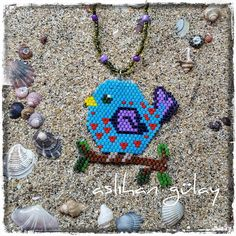 Hungry Bird.. Design by @beaded_bird #motifbeaded_bird #peyotestitch #seedbeads #beads #perline #delice #miyuki #pendant #brickstitch #perlesmiyuki #beadwork #peyotestitch #perlesaddict #beading #miyukiteknigi #beadstitching