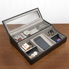 Valet with watch holders and glass cover over the watches