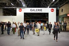 Visitors enjoy the 3,500 square metres of space dedicated to images at the Leica Galerie in photokina Hall 1. There are 650 pictures from all of the exhibiting photographers. The focus of this year's exhibition concept is on impressive photography from the world of music. #DasWesentliche  © DPF