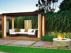Resort-Style Retreat With a luxurious vine-covered privacy wall, a wooden pergola and an outdoor shower, this outdoor space provides a relaxing, resort-like atmosphere. Design by Christopher J. Grubb