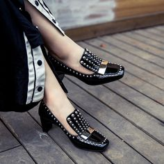 Chiko Maritsa Studded Chunky Heel Loafers feature square toe, studded and metallic strap decorated upper, chunky heel with rubber sole.