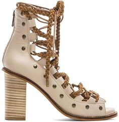 The ultimate guide to every spring shoe trend: lace-up sandals –Free People Pember Lace-Up Heels ($198)