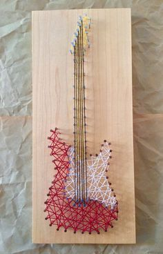 Electric Guitar String Art by MHzStudios on Etsy Rock out with this beautiful representation of an electric guitar, mounted on a stunning board of polished American cherry or maple. String Art Tutorials, String Art Patterns, Nail String Art, String Crafts, Guitar Crafts, Guitar Art Diy, Guitar Pick Art, Box Guitar, Arte Linear