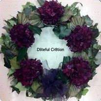 Grapevine base, with silk leaves and gorgeous purple silk hydrangeas.  A purple bow has been added for extra decor.  This can adorn your door during the holidays or year round.  Also available with more flowers and in fall colors.  I can custom make you this same wreath in any color scheme.  I have brown, orange, red, purple, black, green and...