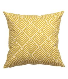 H+M 20x20 yellow cushion cover in woven cotton fabric with a printed pattern at front and solid color at back. Concealed zip.