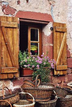 A gathering of baskets beneath the window.
