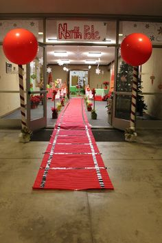 Cute entry way: red butcher paper with black duct tape rails
