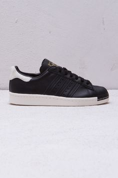 de20f2e9d42 The reigning king of the sneaker world since the these old school Adidas  shoes go deluxe in a premium black leather version