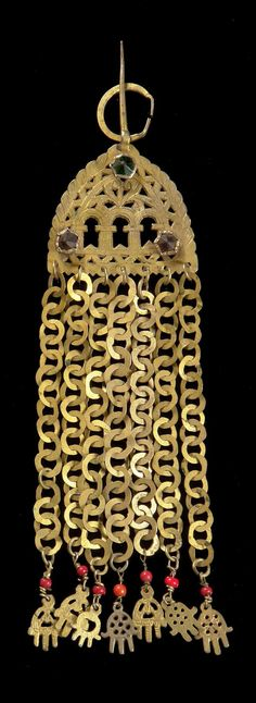 "Africa | Temple pendant (rihana); silver gilt and glass beads; fibula on top for attaching the ornament to fabric and bonnets, showing the three ""mihrab"" openings and seven chains with filigree pendants, depicting hands. 