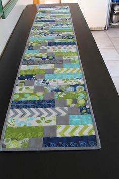One of my goals for the quilt retreat was to make a couple of runners for my long buffet in our kitchen/dining room. The first one I worke...