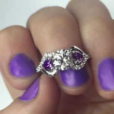 We're feeling passionate about purple today! The Blast Of Love Ring is one of our all time favorites. Two sparkling heart shaped stones accent a radiant center gemstone. Customize the ring in silver or gold with your choice of gemstones. With free shipping, free returns and included gift packaging, it really is the perfect gift!