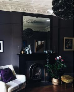 A moody Victorian room in shades of deep purple and black from @around_houses for the November edition of #fearlesshome