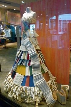 A dress made from books and paper.  You should be all over this Laura!!!